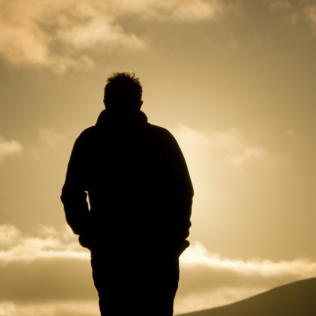 """""""Man walking in sunset"""" stock image"""