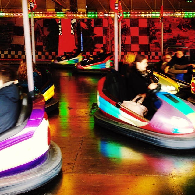 """people have fun driving bumper cars"" stock image"