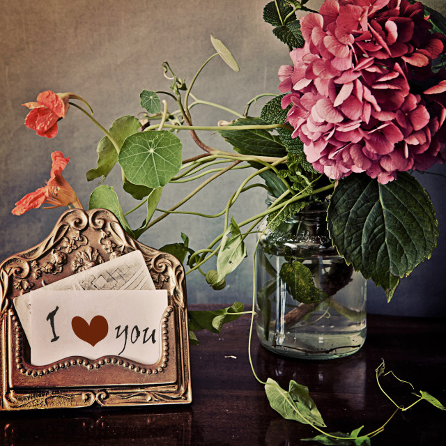"""Vintage still life, brass card holder and pink hydrangea"" stock image"