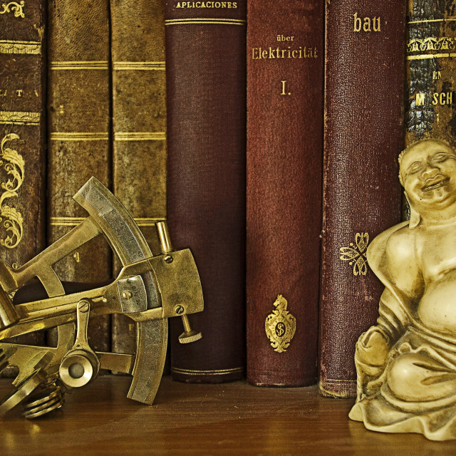 """""""Ancient books, Buddah and sextant"""" stock image"""