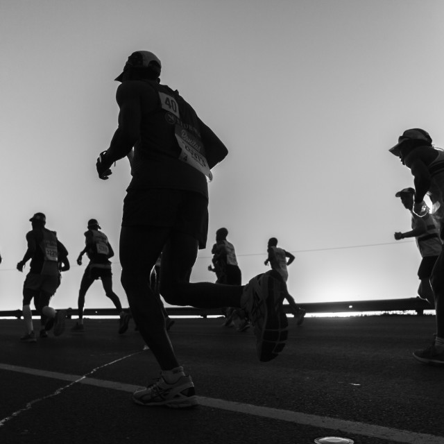 """Marathon Runners Silhouetted Black White"" stock image"