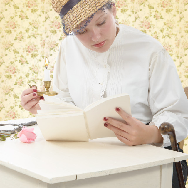 """young woman in vintage costume 1900s read a book"" stock image"