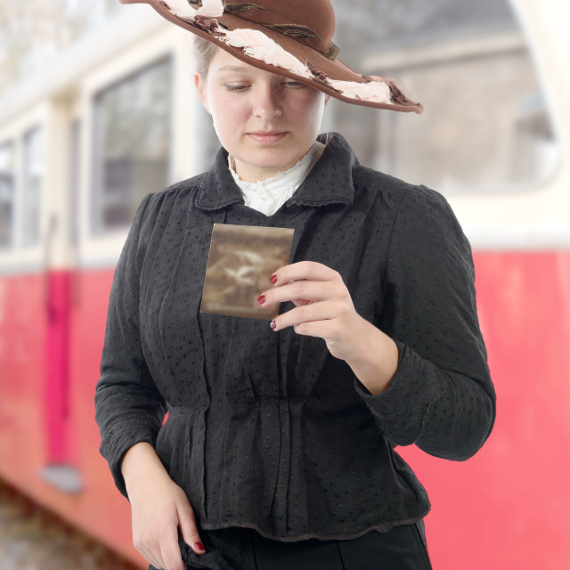 """woman in vintage costume 1900s, old train background"" stock image"