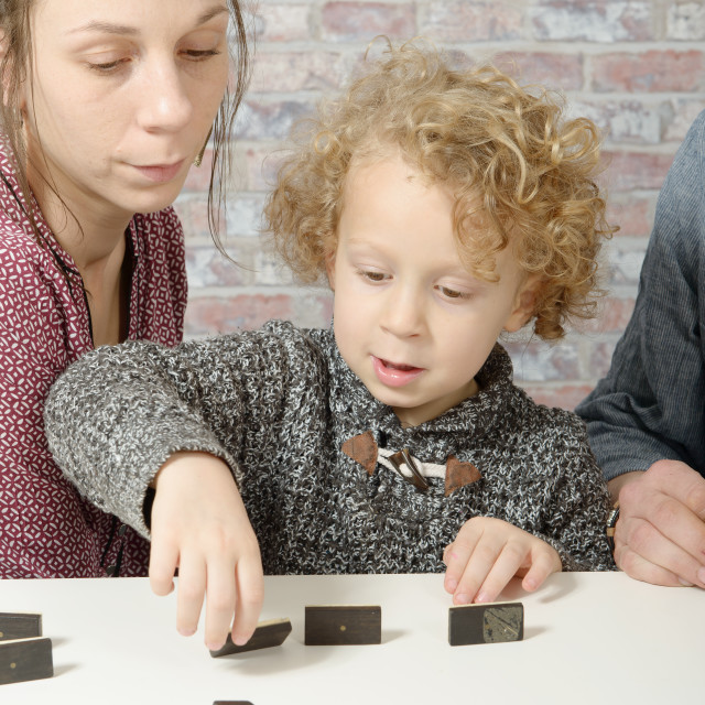 """""""happy family playing dominos"""" stock image"""