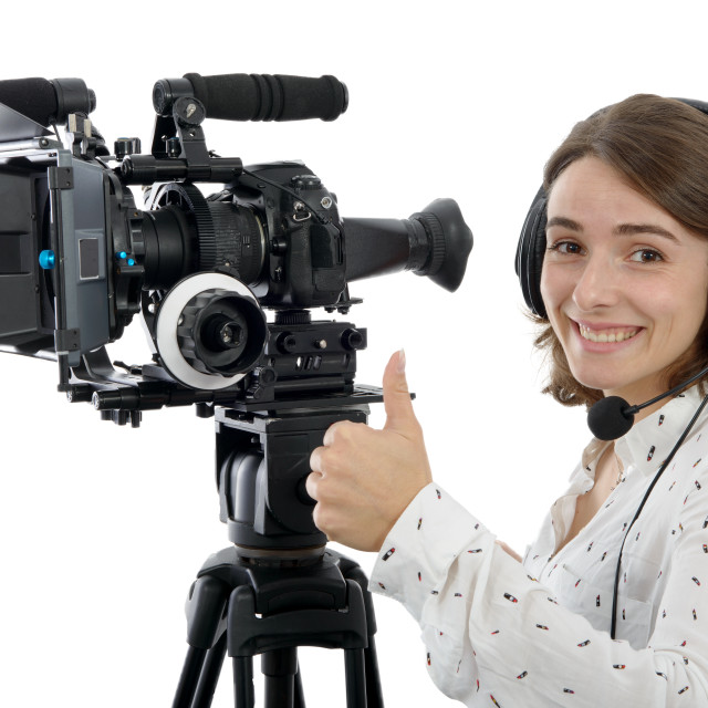 """""""beautiful young woman with DSLR video camera"""" stock image"""