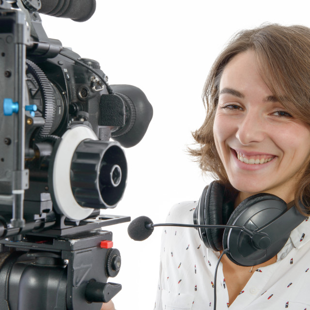 """""""beautiful young woman with SLR video camera"""" stock image"""