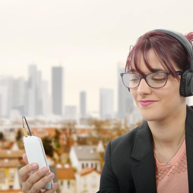 """beautiful girl listening to music with headphones"" stock image"