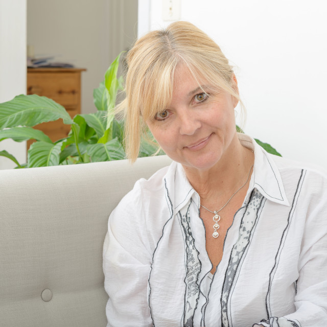 """""""Portrait of mature smiling blond woman"""" stock image"""
