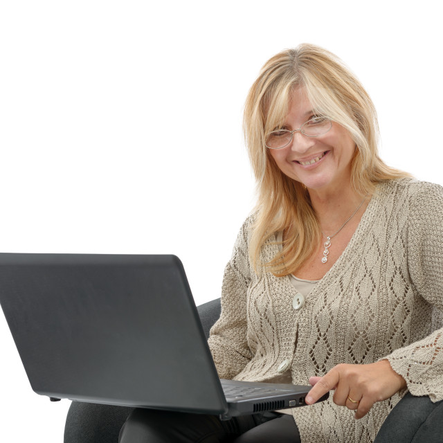 """""""Portrait of a smiling mature woman using laptop"""" stock image"""