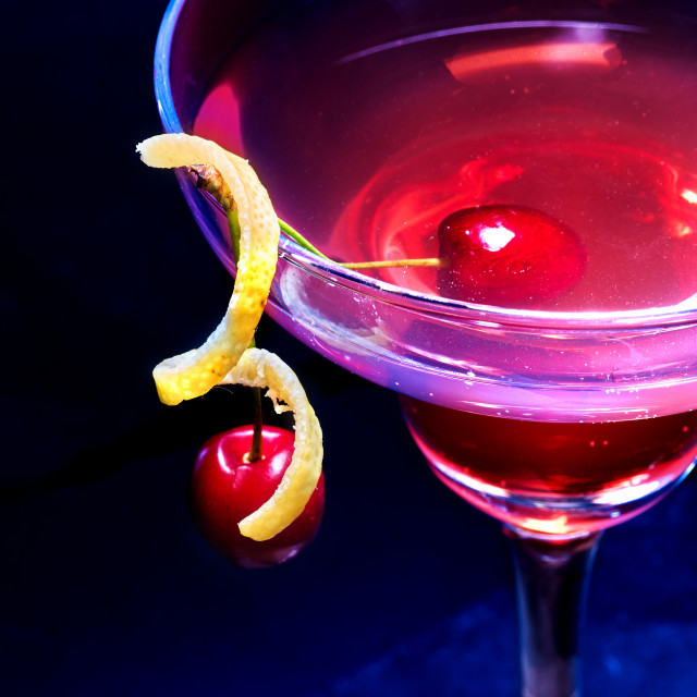 """Non alcoholic drink cherry in cocktail glass on black background."" stock image"
