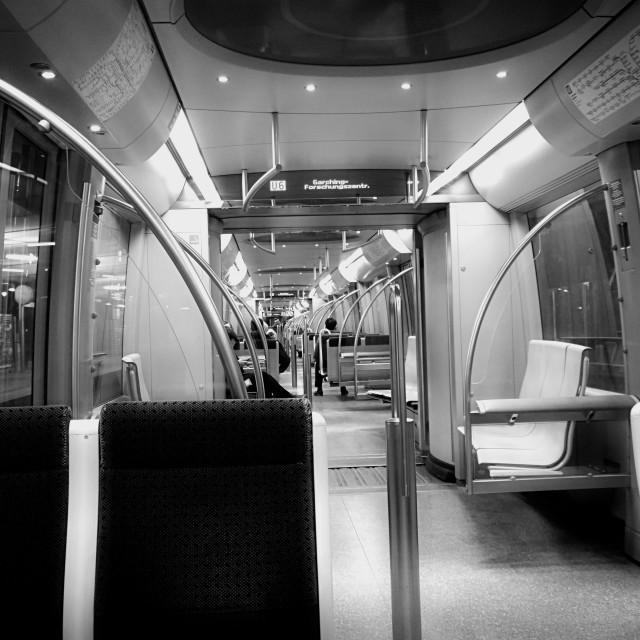 """Munich, returning home in the night, subway train interior"" stock image"