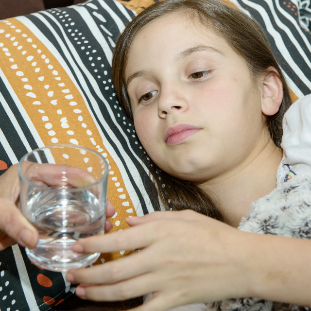 """""""Sick girl drinks a glass of water"""" stock image"""