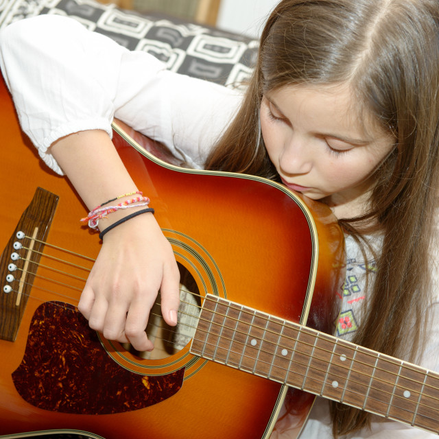 """""""Young teen girl playing acoustic guitar"""" stock image"""