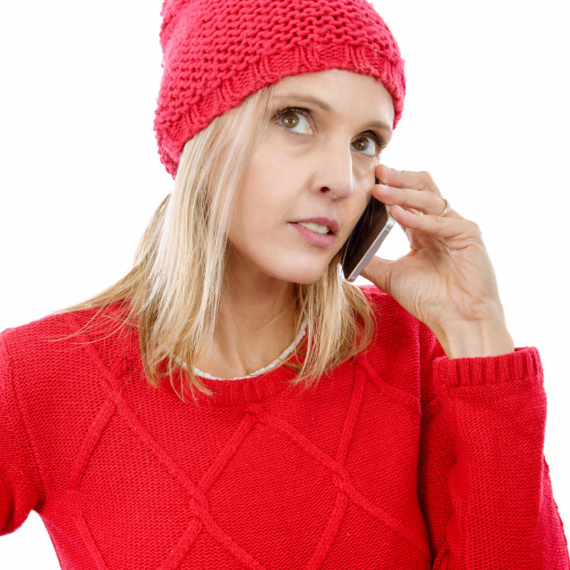 """""""Beautiful young blonde woman with a red cap, phone"""" stock image"""