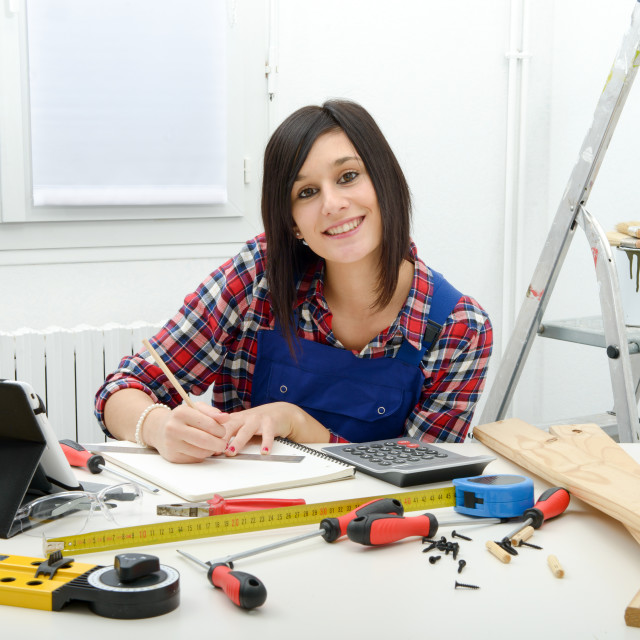 """""""attractive young woman using the tablet for DIY"""" stock image"""
