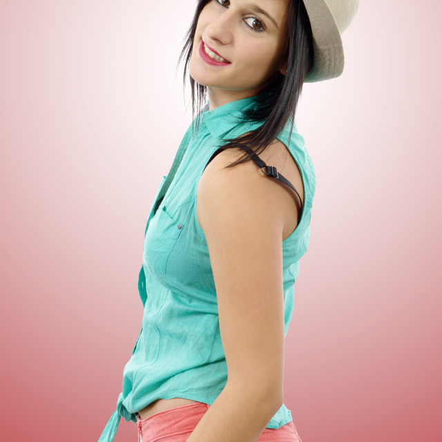 """""""young brunette with a green shirt and pink pants"""" stock image"""