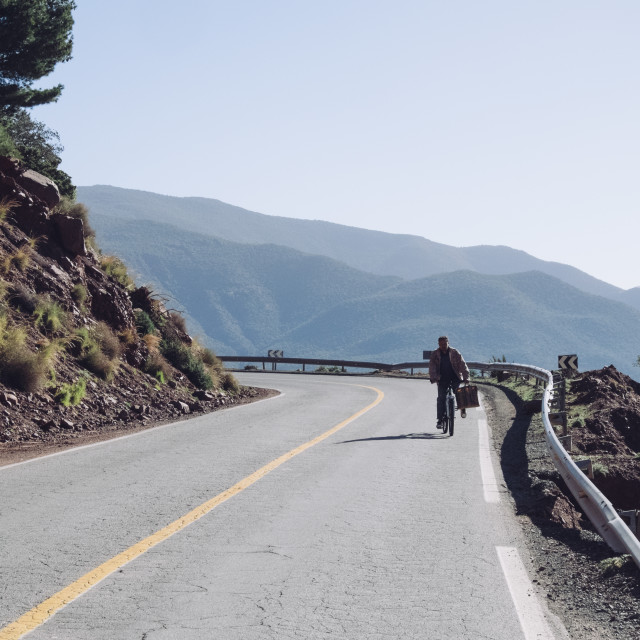 """Man riding up the Atlas Mountains"" stock image"
