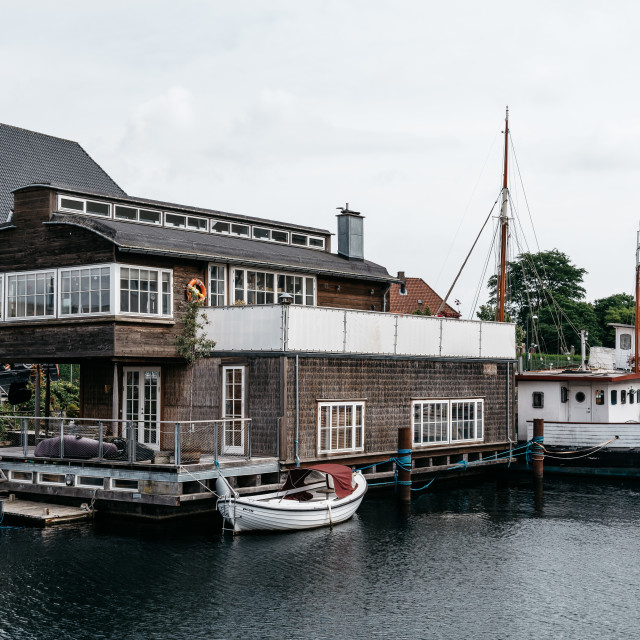 """""""Picturesque house boat in the port of Copenhagen a cloudy summe"""" stock image"""