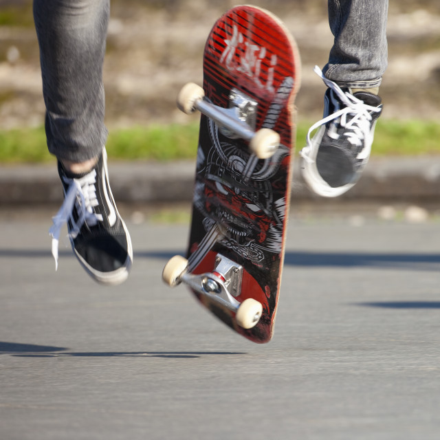 """Skateboarding - detail of skateboard and legs."" stock image"