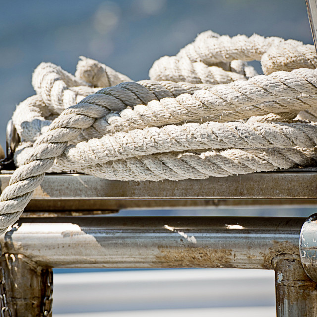 """Rope coil on a sailboat deck"" stock image"