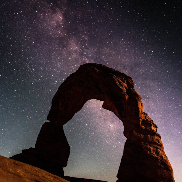 """The Milky Way above Delicate Arch, Arches National Park, Utah"" stock image"