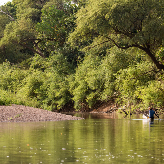 """Fisherman on the Gambia River near Niokolo-Koba National Park in Senegal, West Africa"" stock image"