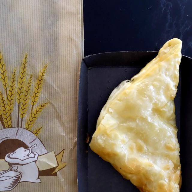 """Greek Fast Food. Take away Cheese Pie, Tyropita"" stock image"