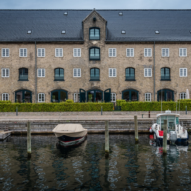 """""""Port of Copenhagen with boats against old building a cloudy summ"""" stock image"""