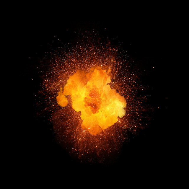 """Realistic fiery explosion, orange color with sparks isolated on black background"" stock image"