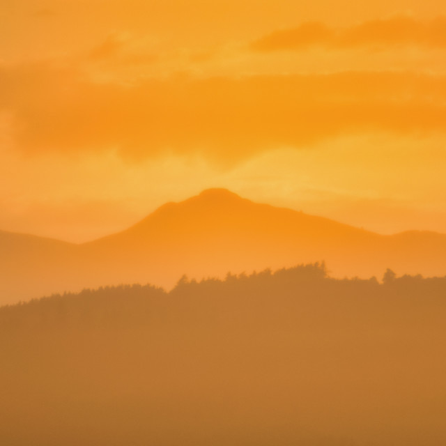 """The sun sets on Bennachie"" stock image"