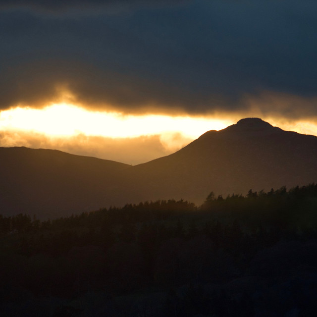 """Moody Bennachie April sunset"" stock image"