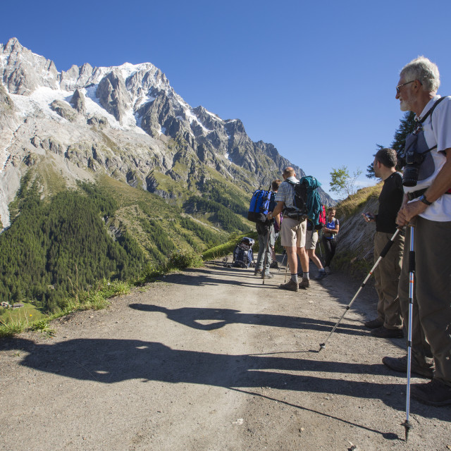 """Walkers doing the Tour du Mont Blanc on Mont de la Saxe above courmayeur in..."" stock image"