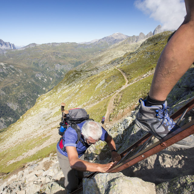 """Walkers ascending ladders on the Aiguille Rouge above Chamonix, France."" stock image"