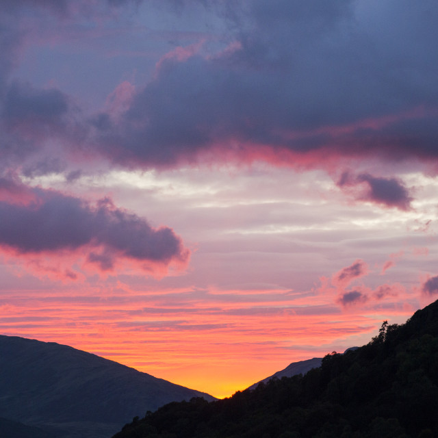 """""""Sunset over Wrynose Pass in the Lake District from Ambleside, Cumbria, UK."""" stock image"""