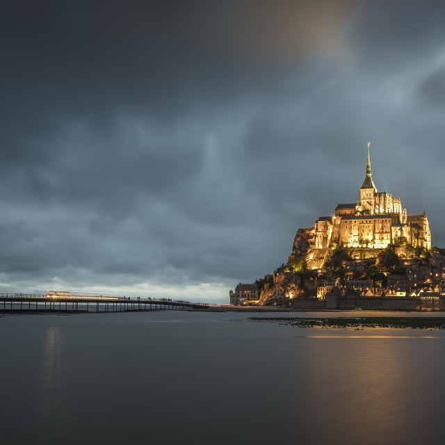 """Cloudy sky at dusk. Mont-St-Michel, Normandy, France."" stock image"