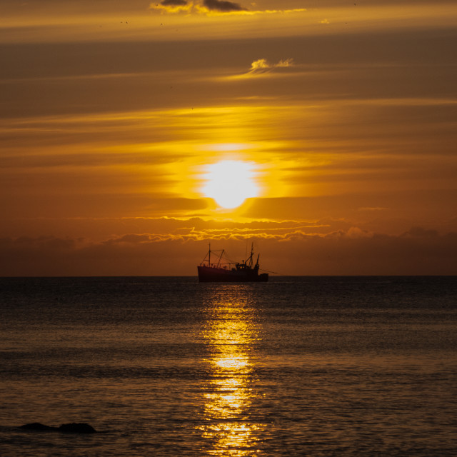 """Sundown With Fishing boat"" stock image"