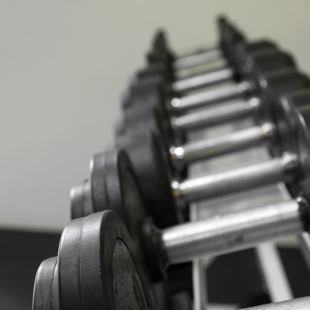 """""""Dumb bells lined up in a fitness studio. picture is short focus"""" stock image"""