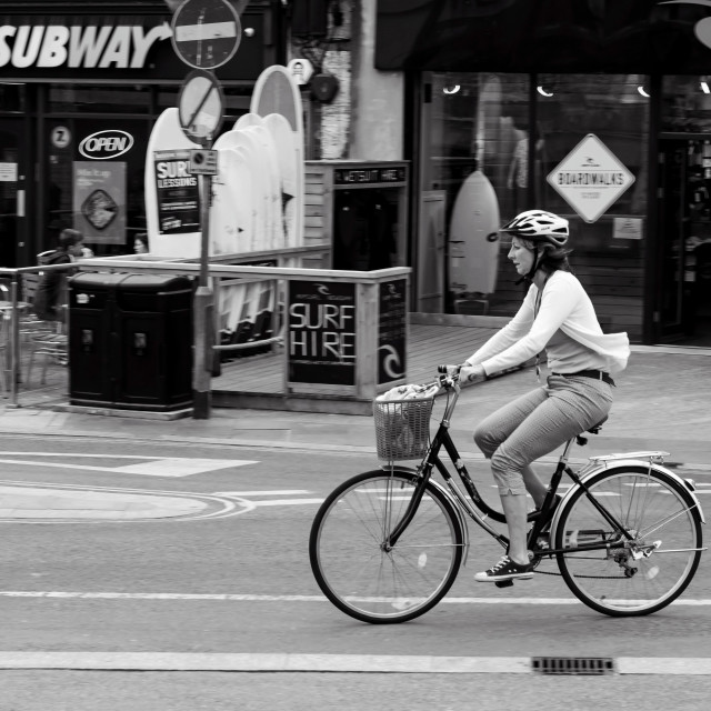 """""""Cycling through town"""" stock image"""