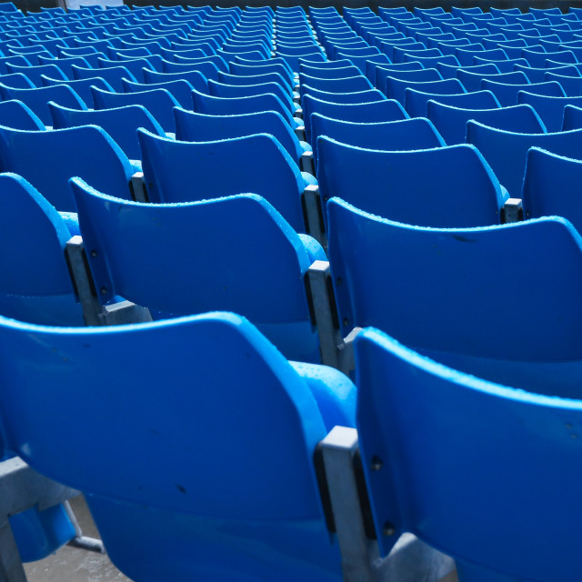 """Blue seats in row"" stock image"