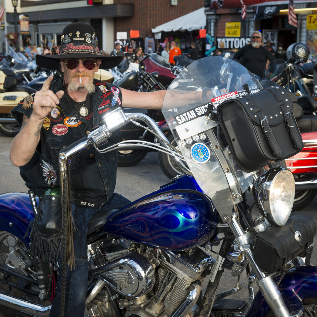 """""""Sturgis, South Dakota - August 9, 2014: Rider in the main street of the city of Sturgis, in South Dakota, USA, during the annual Sturgis Motorcycle Rally"""" stock image"""