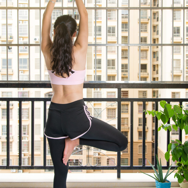 """""""Girl in Tree yoga pose at home"""" stock image"""