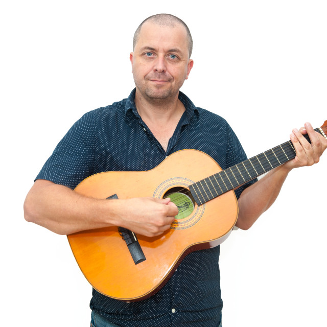 """""""Man holding an acoustic guitar."""" stock image"""