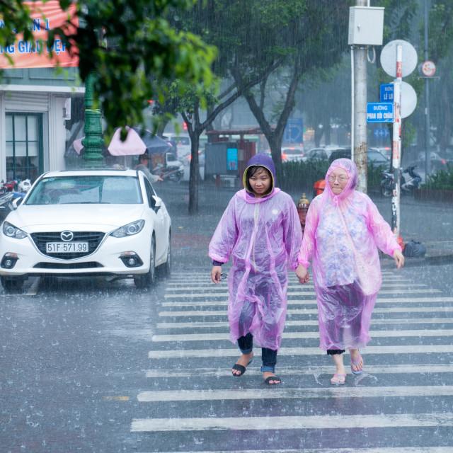"""Ho Chi Minh City/Saigon Vietnam Heavy rains pink rain poncho's."" stock image"