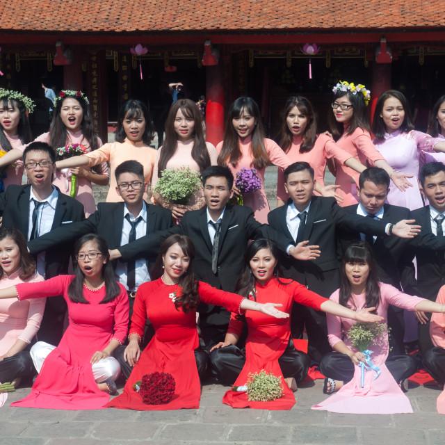 """Hanoi Vietnam Graduates pose for group photos at Temple of Literature (Van Mieu Quoc Tu Giam)"" stock image"