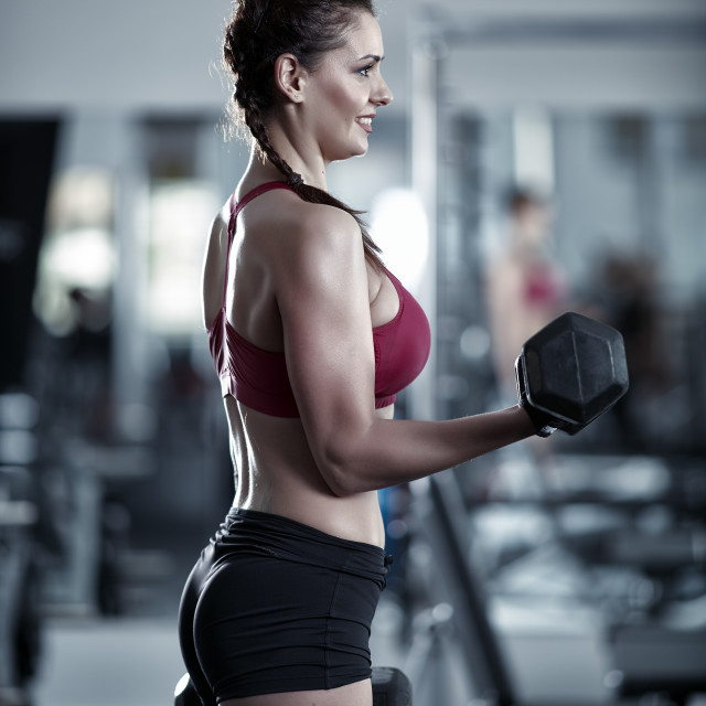 """""""Young woman doing biceps workout"""" stock image"""