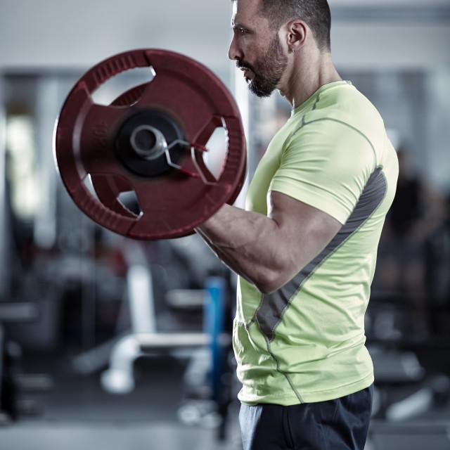 """Man doing biceps curl"" stock image"