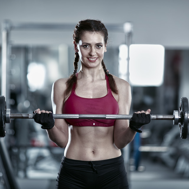 """""""Woman doing barbell biceps curl"""" stock image"""