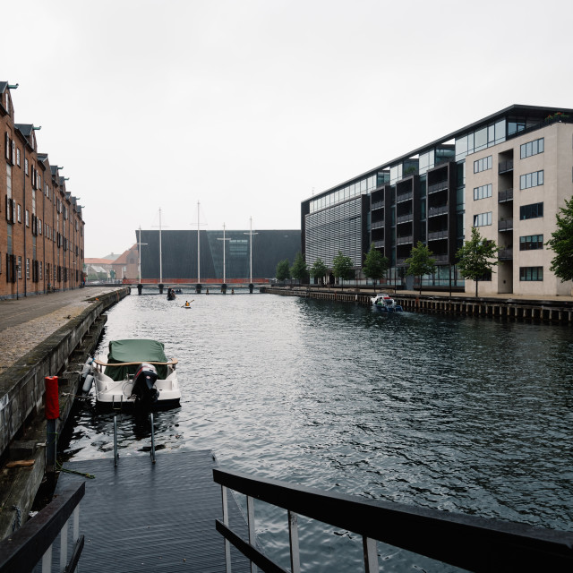 """""""Port of Copenhagen with boats moored against old and new buildin"""" stock image"""