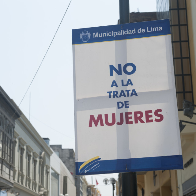 """""""Lima Peru Council signs throughout the city demanding no to trafficking in women. The global slavery index 2014 estimates that there are more than 66000 people in modern day slavery in Peru, many of which from indigenous communities."""" stock image"""
