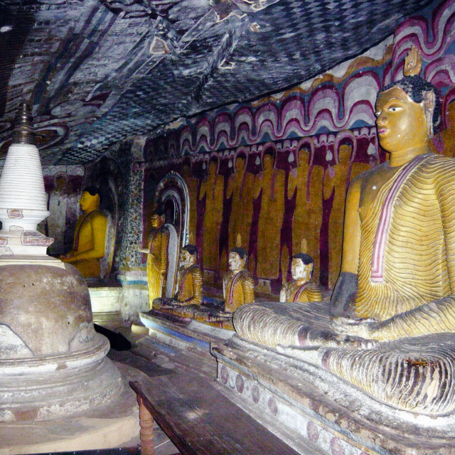"""Buddha statues and chorten in Roack temple, Dambula, Sri lanka."" stock image"